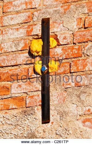 steel-reinforcing-bar-and-expanding-foam-insulation-on-old-brick-wall-c261tp.jpg